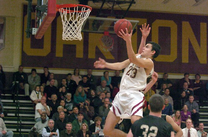 Oakton senior Michael Fradette scored 18 points and grabbed 12 rebounds against Westfield on Feb. 8.