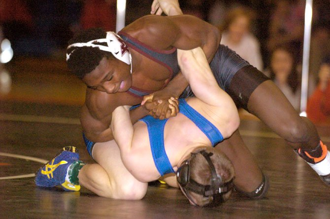 Mount Vernons Bill Adusei, top, defeated Robinsons Austin Riggs via 12-5 decision to win the 126-pound title at the Northern Region wrestling meet on Feb. 9 at Hayfield Secondary School.