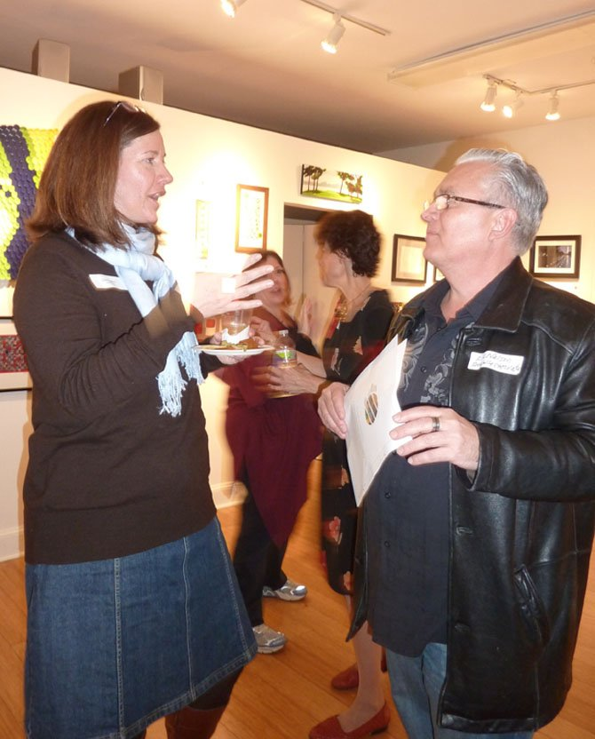 Diane Ruggiero and artist Eric Nelson.