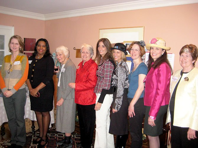 From left, school board member Pat Hynes; Del. Charniele Herring; former State Senator Patsy Ticer; former Board of Supervisors Chair Kate Hanley; Del. Eileen Filler-Corn; Virginia Million Mom March Chair Martina Leinz; Fairfax County Democratic Committee Vice Chair South Ruth Miller; school board member Tammy Kaufax, former State Senator Mary Margaret Whipple.