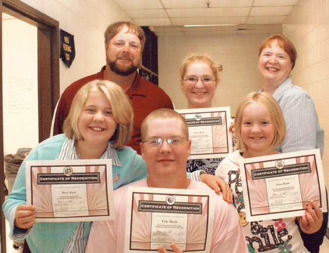In October, 2010, The Nottoway County School Board presented certificates of recognition to all four Rash children for achieving perfect SOL test scores. From left, top row: Ricky, Sarah and Diane Rash; bottom row: Mary, Eric and Anna Rash. 
