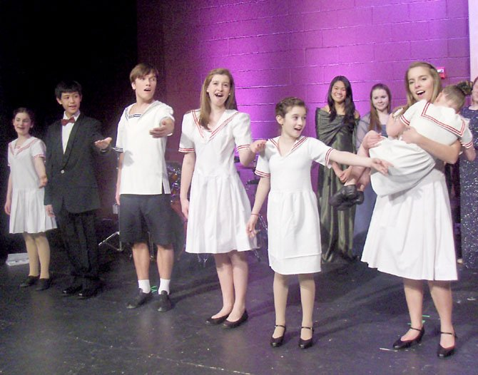 Performing as the Von Trapp children are (from left) Grace Shields, Marc Manaloto, Dimitri Gann, Aubrey Cervarich, Maya Tischler and Robinson student Carys Meyer, holding Dorothy Cervarich.