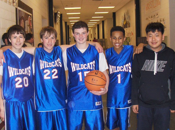 Playing in Saturday's basketball tournament were SYA Wildcats (from left) Nathan Lee, Trent King, Carter Egbers and Robert Okoro. At far right is their friend Young Lee, and they're all Liberty Middle eighth-graders.