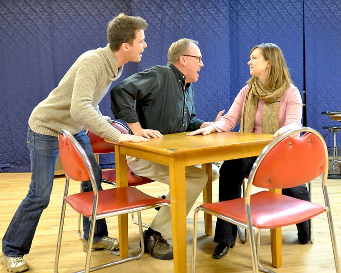 "From left, Terry Barr in his role as Gabe, Harv Lester in his role as Dan, and Jolene Vettese in her role as Diana in a rehearsal for the Reston Community Players' production of the ""Next to Normal."""