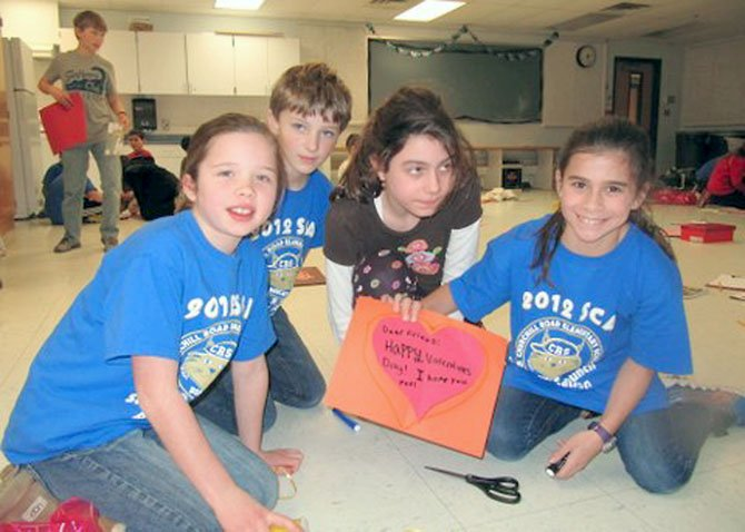 Churchill Road Student Council representatives Liliana Schone, Connor Farah, Catie Williams and Alexandra Bair create a Valentine's card to go with the care package they made for a pediatric patient at INOVA Fairfax Children's Hospital.