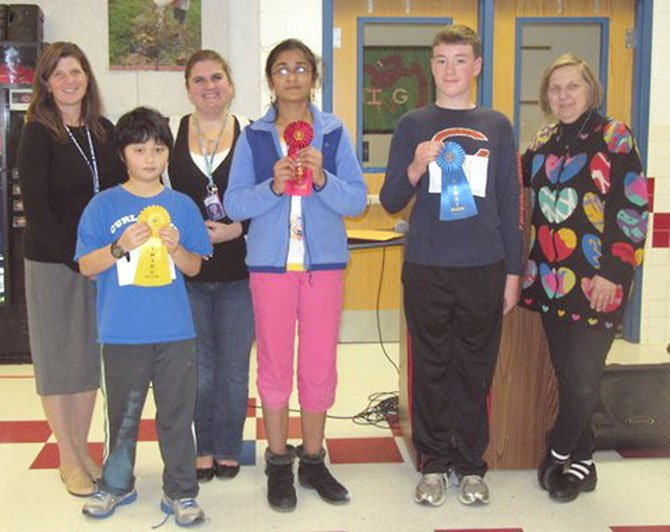 Churchill Road Spelling Bee Winners (from right) Matthew Cox (first), Soumya Peri (second) and Eric Gan (third) show off their ribbons. Also pictured are teacher sponsors Cindy Zemke, Jennifer Williams and Jan Clark.