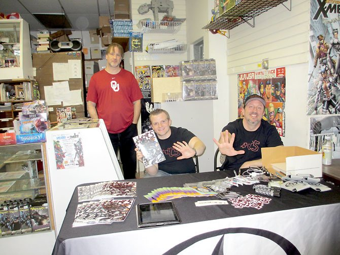 "E.G. Comics owner Edwin Gumel hosts ""Unit 5"" creators Alex Robson and Skip Winter. Koons Scion of Tysons Corner sponsored the launch event at the comic book store, with prizes and refreshments, on Saturday, Feb. 16."