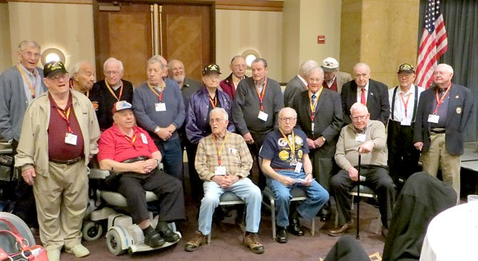 Iwo Jima veterans  gather for a group photo Feb. 16 during a reunion marking the 68th anniversary of the battle.