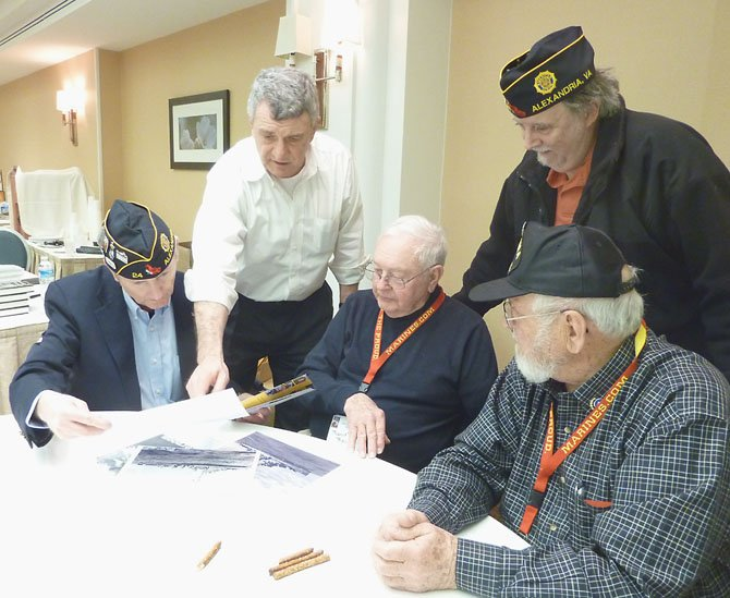Members of American Legion Post 24 in Old Town visit with WWII veterans during a reunion of Iwo Jima survivors in Arlington Feb. 15. Shown are Henry Dorton, Commander Bill Aramony, Bob Rigger, Jim Glassman and Ira Rigger.