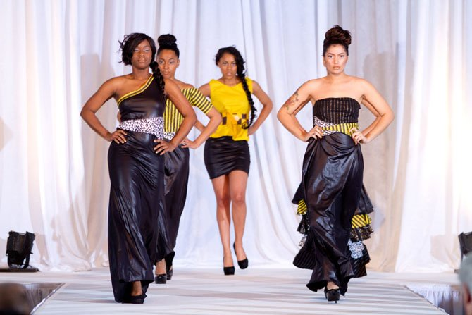 From left: Camille Chandler, Kendra Hyater-Davis, Charlene Fowler and Alecia Mason of Marymount University in Arlington model designs by Marymount alum Ashleigh Holmes during the 2012 Voyage to Utopia Fashion Show. The annual event, which raises money for charity, is held during Black History Month.