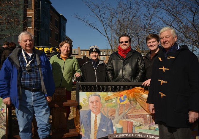 From left: Brad Lampshire, Kristine Lampshire DeFreitas, Nathan Lampshire, Greg Lampshire, Jared Lampshire, and Geff Lampshire — all descendants of Harvey Lampshire, depicted on the Cherrydale Library mural.