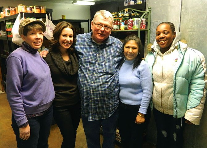 Sarah Heckman, second from left, takes a break with her pantry volunteers Karen Johnson, Bill Walters, Mena and Nichola Carter.