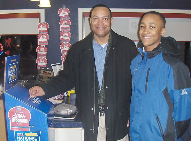 Little Rocky Run's Brandon Brown and son Myles are happy to contribute to LLS during the Centreville IHOP fundraiser.