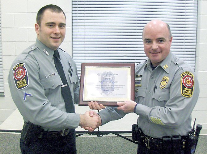 PFC Joe Shields (on left) is congratulated by police Capt. Ed O'Carroll for being the Sully District Station's 2012 Officer of the Year.