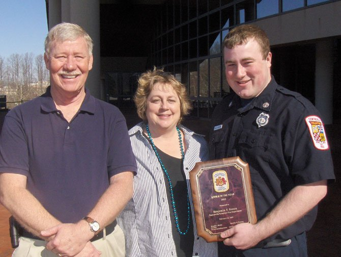 Parents George and Anne Sisson with their son Ben, Fairfax County's 2012 Volunteer Rookie Firefighter of the Year.