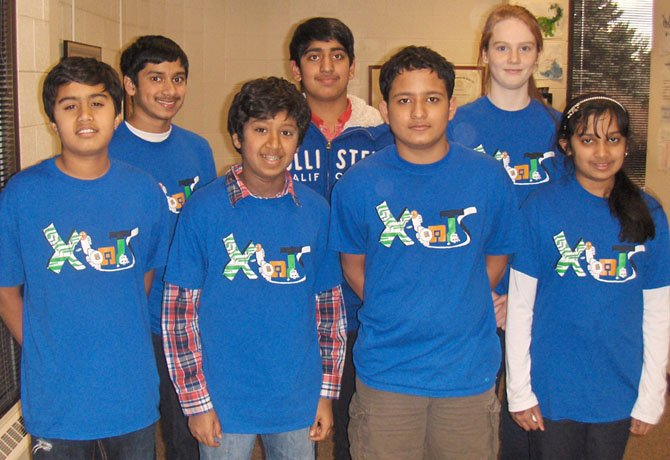 Back row, from left, are X-BOTS team members Nikhil Chintada, Satish Venkatesan and Sarah Maxseiner; and (front row, from left) Ahan Shah, Sidharth Rampally, Rishabh Venketesh and Anoushka Chintada.