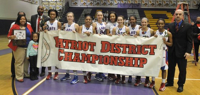 The T.C. Williams girls' basketball team won the Patriot District championship on Feb. 15.