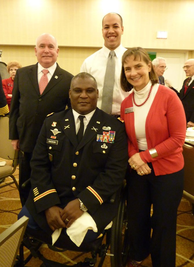 Keynote speaker Col. Gregory Gadson, center, visits with Mary Scott, board chairman of the Alexandria-based National Military Family Association, Gen. Bruce Scott (ret.) and West Point senior cadet Caleb Bloom prior to the Feb. 18 breakfast.