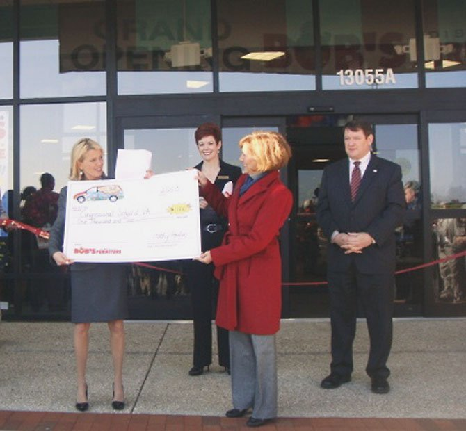 Cathy Poulin, Bob's Discount Furniture public relations director, presented a $1,000 donation to Jayne Shedd, director of development for the Congressional Schools of Virginia, at the Fairfax store opening. Also pictured are Colleen Wood, Bob's Discount Furniture area manager and acting store manager for the new Fairfax store, and Supervisor Pat Harrity (R-Springfield).