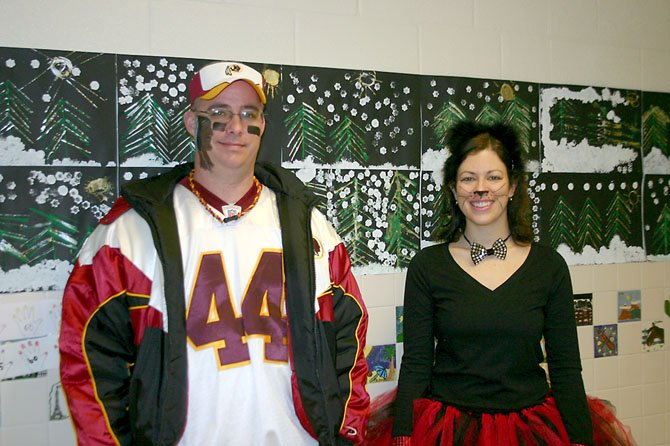 Fairview Elementary P.E. Teachers Fred Pechin and Kendra Roland dress up after students collect 5,671 Box Tops during contest. 