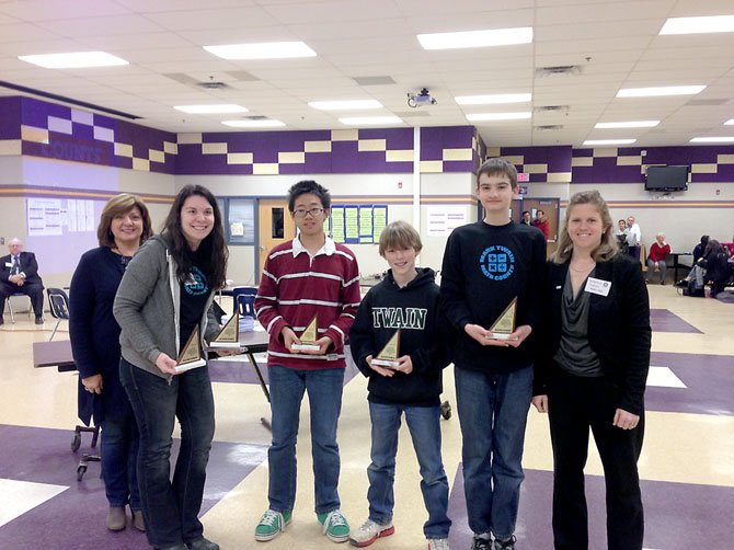 From left, Lynn Gilmore (corporate citizenship director, Northrop Grumman Information Systems), Rachel Moneypenny, Peter Zhao, Caulton Wilson, Zachary Hayden and Heather Naples (president, Brown Construction Services) pose after the trophy presentation at this year's MATHCOUNTS regional competition.
