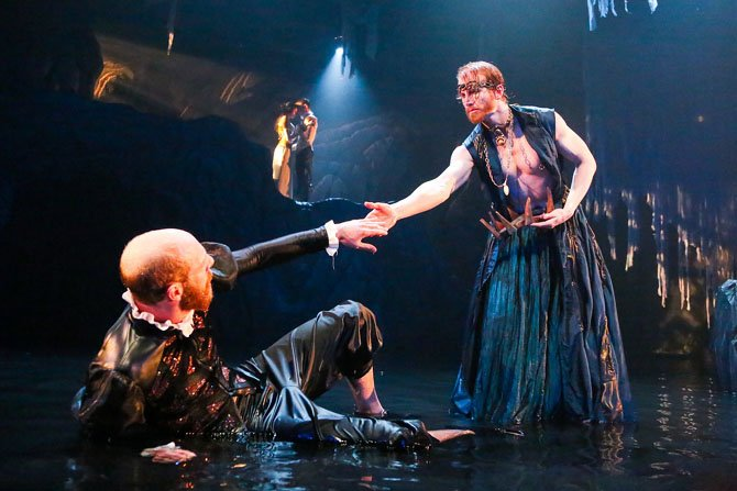 Ryan Tumulty as Alonso and Philip Fletcher as Prospero; Irina Kavsadze as Miranda and Scott Brown as Ferdinand (in background).