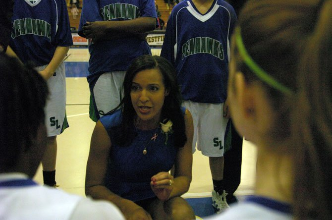 South Lakes girls basketball coach Christy Winters-Scott speaks to the Seahawks during the Northern Region championship game against Edison on Saturday, Feb. 23, at Robinson Secondary School.