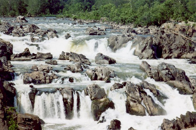 Great Falls in Summer captures the power and grandeur of the communitys namesake. This photo, taken from Leggetts book Visions of Great Falls, is on display at the library through March.