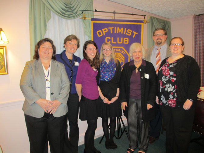 The Optimists of Greater Vienna awarded cash prizes to three area high school students who won the local 2013 Optimists International essay competition. Left to right is Optimist Club of Greater Vienna president Laurie Cole, parent Sandy Le Duc, third-place winner Megan Le Duc, first-place winner Taylor Austin, education committee chair Barbara McHale and Taylor's aunt and uncle, Laura and Carlton Colter. Third-place winner Olivia Hammermaster was unavailable.
