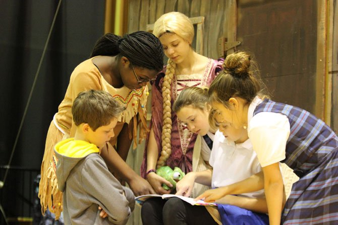"Washington Episcopal Grade 6 students (from left) Piers Greenan, Morinsola Tinubu, Sophia Mishurny-Santini, Libby Scanlon, Juliet Faris, and Casey Davis consult the script as they rehearse ""The Little Mermaid Jr."""