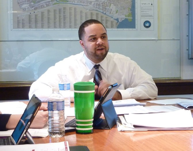 City Manager Rashad Young reviews his proposed 2014 $626.6M budget during a media briefing Feb. 26.