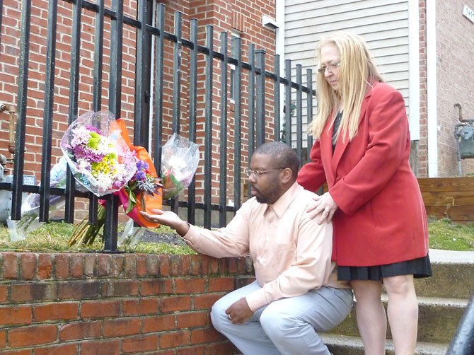 Marshall Love and Melinda Sigal pay their respects at the scene where Taft Sellers was killed in an Alexandria police-related shooting Feb. 18. Both witnessed the incident from across Duke Street.
