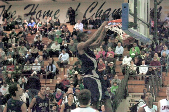 South County senior Oren Burks dunks against Woodson in the Northern Region tournament semifinals on Feb. 22 at Robinson Secondary School.