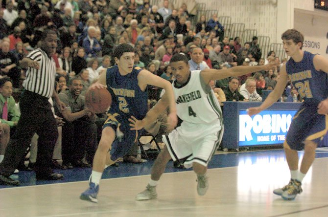 Robinson's Matt Fall, left, dribbles against Wakefield's Khory Moore in the Northern Region semifinals on Feb. 22.