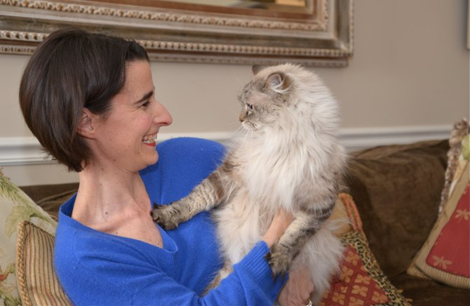 Jennifer Boysko shares a moment with maybe 12-year-old Sam, her daughter Sophie Claire's sixth birthday request back in 2004. Sam, like many family cats, likes to set the family rules ... in particular bed times.