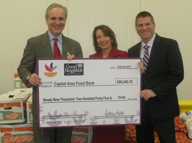 Anthony Hucker, president, Giant Food of Landover, Md.; Nancy Roman, president and CEO, Capital Area Food Bank; Brian Shelton, Giant Food of Landover, Md. vice president of finance and member of Capital Area Food Bank's Board of Directors.