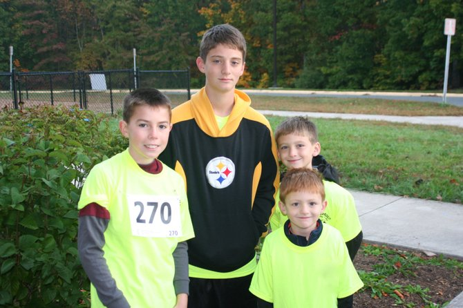 Youth look forward to the color misting at this year's Color Fun Run for Technology at Halley Elementary. From left: Zach Burcher, Will Ardrey, Chris Ardrey and Michael Ardrey after finishing last year's race.