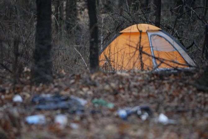 Encampments like this were found scattered around the Lorton area, usually near major shopping areas, but sometimes in isolated fields. Not all encampments had tents for people to sleep; volunteers often found old couches and sleeping bags, or temporary shelters made of cardboard, plastic and scrap pieces of wood. 