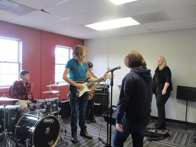 Vienna School of Rock students rehearsing for their March 9 gig with guitar rock legend Earl Slick.