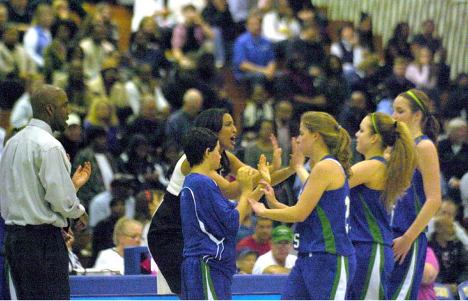 South Lakes girls' basketball coach Christy Winters-Scott encourages members of the team during the state quarterfinals on March 1 at Robinson Secondary School.
