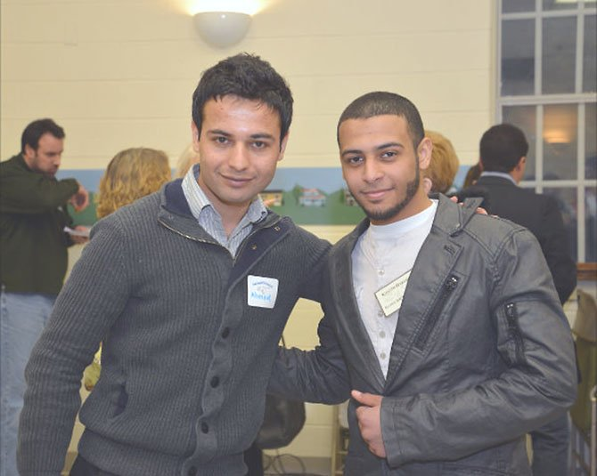 Ahmad Shah Hemmat, one of the guest speakers, talks with award recipient Khaled Hasanin, a senior at Islamic Saudi Academy Boy's School. Ahmad attended the Seeds of Peace camp for children from regions of conflict and continues to promote the message of peaceful conflict resolution today. Khaled founded the Islamic Club at his school to help promote good behavior in the lower grade levels.