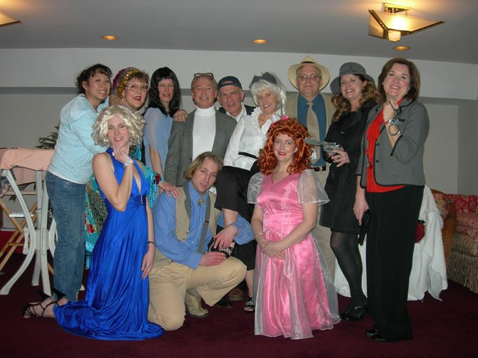 Cast photo: (standing, from left) Director Charlotte Yakovleff, Helen Rusnak, Lynne Strang, Charles Hoffman, Fred C. Lash, Jolanda Janczewski, James Manchester, Terri Grimes-Marin and Teri Pierce; (kneeling, from left) are Stephanie Lawrence, Eric Rogotsky and Nichole Klocke de Rodriguez.
