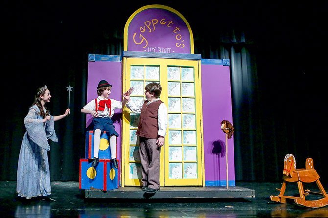 Emma Kelly as the Blue Fairy, John Ray as Pinocchio and Aidan White as Geppetto.