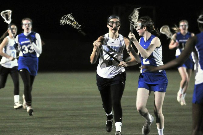 Senior midfielder Jennie Basile led Yorktown with four goals during a 12-11 victory over West Potomac on March 11.