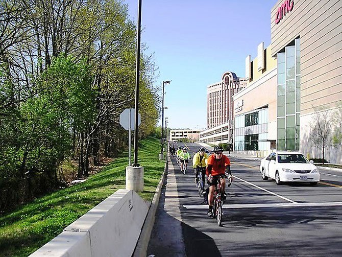 "A group of local cyclists take advantage of the good weather during a ride to Tysons Corner. To find ""bike-friendly"" paths in Fairfax County, go to www.fairfaxcounty.gov/fcdot/bike/bikemap."