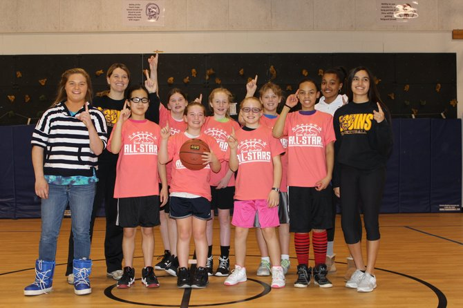 Pictured from left: (front) Lake Braddock player Betsy Gallier, Burke basketball All-Stars Jenny Li, Lindsay Brandow, Angela Voelkel and Rayvean Betts, Lake Braddock player Nirali Shah, (back) Lake Braddock girls' head coach Leigh Janis, Burke basketball All-Stars Emma Wolan, Dacey Burgess and Jordan Payne, and Lake Braddock player Hermela Arcudi.