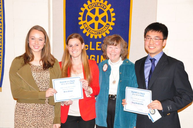 From left, Langley High School junior Rebecca Pifer, Potomac School senior Britt Nelson, McLean Rotary Club President Jan Auerbach and McLean High School senior Jung Wook Choi. The McLean Rotary awarded the three students $250 scholarships Tuesday, March 12, for their service to the community.