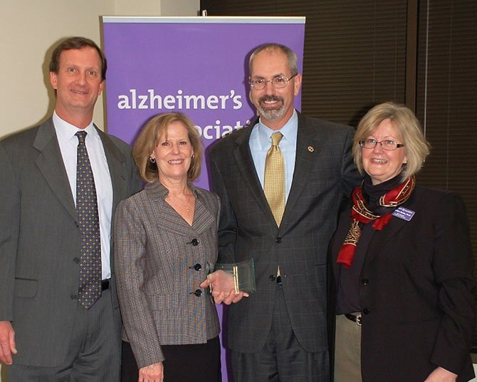 From left, Alzheimer's Association National Capital Area Chapter Board Chair Jordan Smyth, Martha Gow, Rick Gow, and Alzheimer's Association National Capital Area Chapter Vice President of Programs and Services Dr. Candice Rettie.