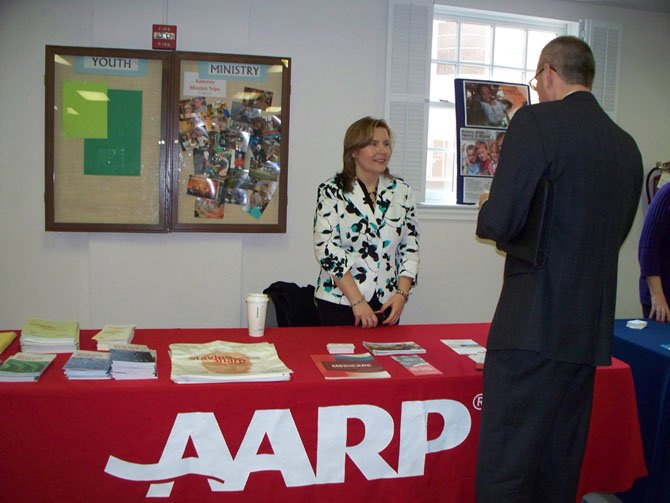 Amber Nightengale from AARP discusses memory coping resources with workshop attendee.