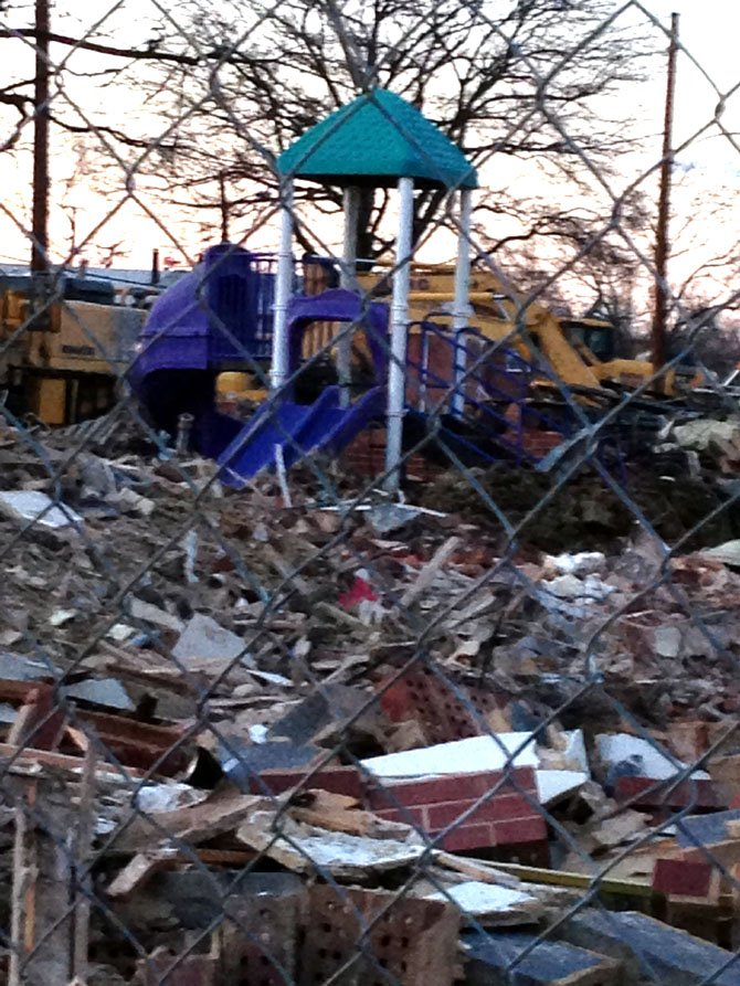 A playground remains amidst the rubble of demolition making way for new construction on N. Columbus Street.